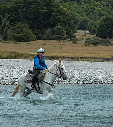 Heather and Cloud on A River Crossing on the Day Ride From Boundary Hut, Wild Womens Expeditions with Adventure Horse Trekking New Zealand