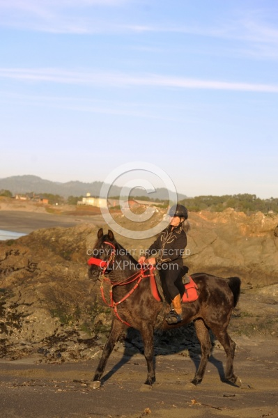 Lari Shea of Ricochet Ridge Ranch riding on the beach